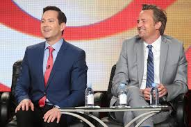 """Thomas Lennon, left, and Matthew Perry speak onstage during """"The Odd Couple"""" panel as part of the TCA press tour in Pasadena on Monday. The new CBS series, in which Lennon will play Felix Unger and Perry will play Oscar Madison, will premiere Feb. 19. (Frederick M. Brown / Getty Images)"""