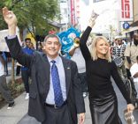 Event hosts Jay Dardenne and Faith Ford lead a post-brunch second line