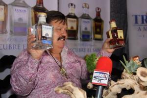 Ramon Ayala holding his Tragos Amargos Tequilas