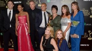 BEVERLY HILLS, CA - JUNE 22:  The cast and crew of ìThe Young and the Restlessî pose in the press room with the award for Outstanding Drama Series during The 41st Annual Daytime Emmy Awards at The Beverly Hilton Hotel on June 22, 2014 in Beverly Hills, California.  (Photo by Jason Kempin/Getty Images)