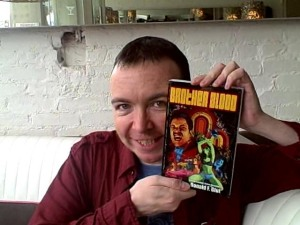 Why it's James Moran, writer of episodes of DOCTOR WHO and TORCHWOOD: CHILDREN OF EARTH showing off his copy of BROTHER BLOOD
