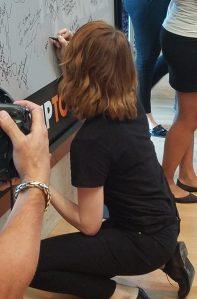 Emma Stone writing on SU2C board