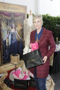 """The """"Hollywood Game Night"""" host checked out the gorgeous gowns from VIP sponsor Sue Wong Couture at Doris Bergman's Seventh Annual Emmy Style Lounge & Party. Photo: Courtesy Of Doris Bergman"""