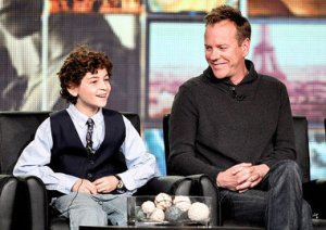 """Danny Moloshok / The Associated Press Executive producer and cast member Kiefer Sutherland (right) and co-star David Mazouz smile during the panel discussion for the Fox television show """"Touch"""" at the Fox Broadcasting Company Television Critics Association Winter Press Tour in Pasadena, Calif., on Sunday, Jan. 8, 2012. Sutherland said Sunday he expects to start filming a movie based on """"24"""" in the spring."""
