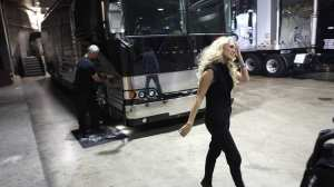Carrie Underwood heads out from her tour motorhome on her way to a radio interview at Staples Center. (Brian van der Brug / Los Angeles Times