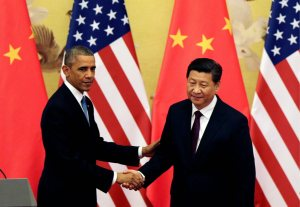 U.S. President Barack Obama, left, shakes hand with Chinese President Xi Jinping after their press conference at the Great Hall of the People in Beijing, China Wednesday, Nov. 12, 2014. (AP Photo/Andy Wong)