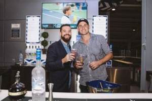 Former professional tennis player, Andy Roddick mixes the iconic Grey Goose Honey Deuce cocktail for fans at the 2016 U.S. Open in New York.