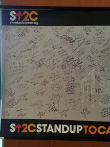 Stand Up 2 Cancer board of words & signatures