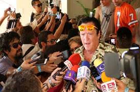 Michael Madsen answers press inquiries during the event