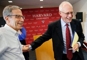 Oliver Hart, right, the Andrew E. Furer Professor of Economics at Harvard, and Nobel laureate Eric Maskin, economics 2007, also from Harvard, laugh together following a news conference at Harvard in Cambridge, Mass., Monday, Oct. 10, 2016. Hart and Finnish economist Bengt Holmstrom, of the Massachusetts Institute of Technology, shared the 2016 Nobel Economics Prize for their contributions to contract theory. (AP Photo/Michael Dwyer)