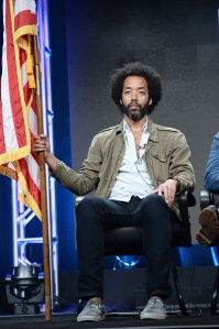 "BEVERLY HILLS, CA - JULY 31:  (L-R) Actor Wyatt Cenac of ""People of Earth"" speaks onstage during the TCA Turner Summer Press Tour 2016 Presentation at The Beverly Hilton Hotel on July 31, 2016 in Beverly Hills, California. 26301_001  (Photo by Charley Gallay/Getty Images for Turner)"