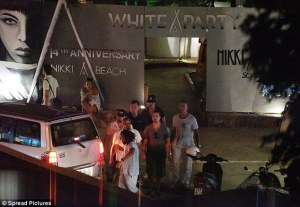 Caribbean party-hopping: The 41-year-old leading man was surrounded by his entourage as he emerged from Nikki Beach St. Barth's white party Read more: http://www.dailymail.co.uk/tvshowbiz/article-3383355/Leonardo-DiCaprio-parties-bro-posse-Nikki-Beach-St-Barth-girlfriend-Kelly-Rohrbach-rings-2016-Connecticut.html#ixzz4T1M3O7