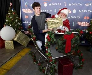 Nolan Gould surprises 150 children from Children's Hospital Los Angeles and P.S. ARTS at Delta Air Lines' sixth annual Holiday in the Hangar Celebration at LAX on December 13, 2016